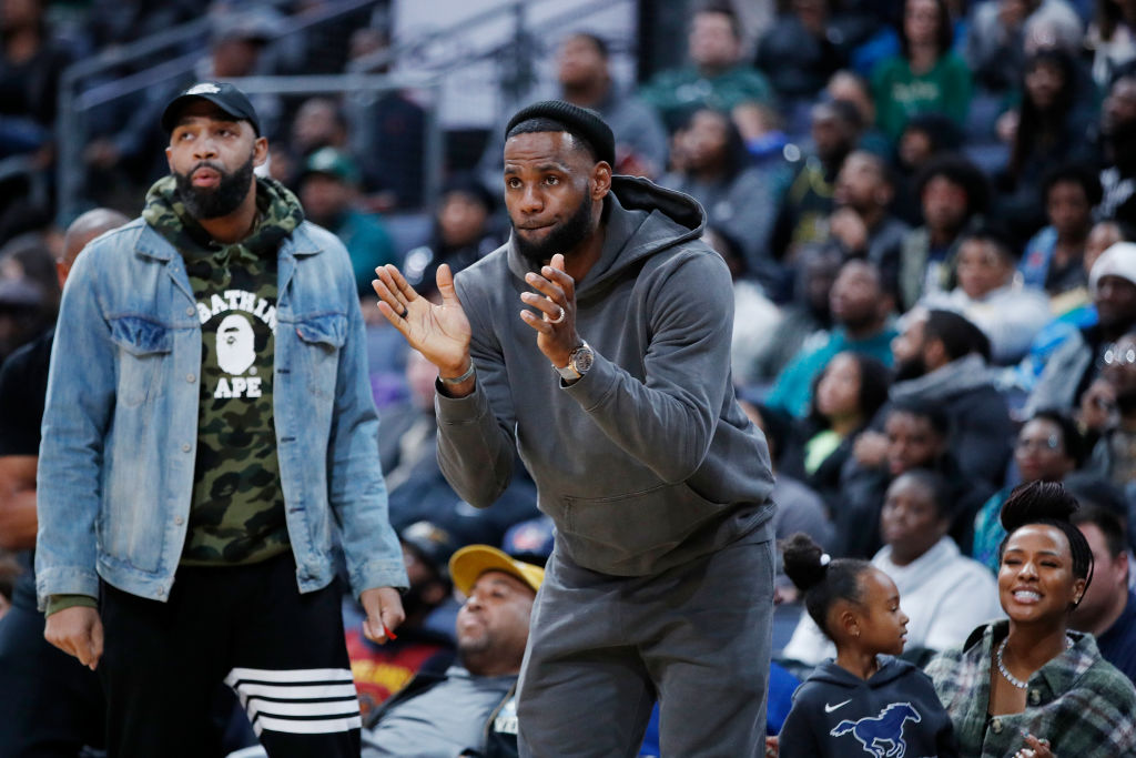 LeBron James of the Los Angeles Lakers reacts while watching son Bronny play with Sierra Canyon High School