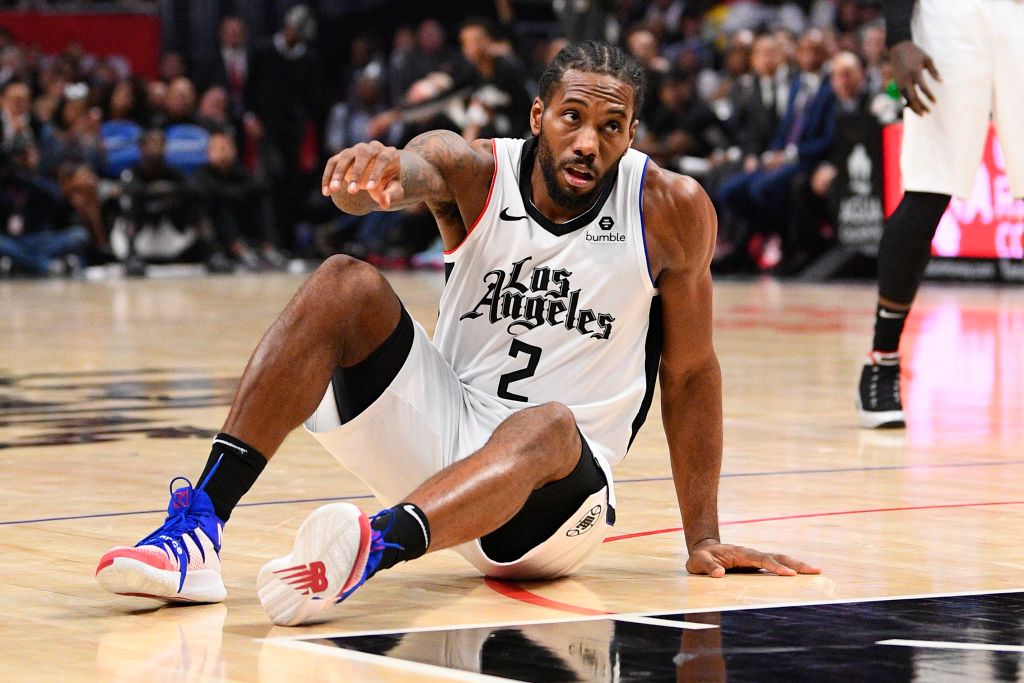 Kawhi Leonard getting up after falling down on the court.