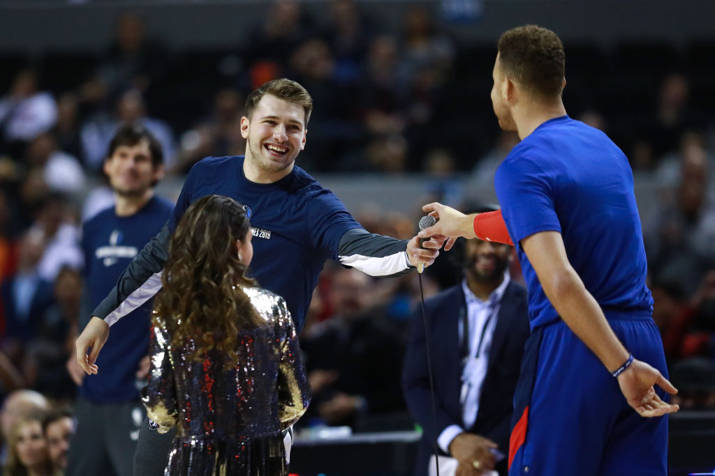 Luka Doncic of the Dallas Mavericks and Blake Griffin of the Detroit Pistons during a game