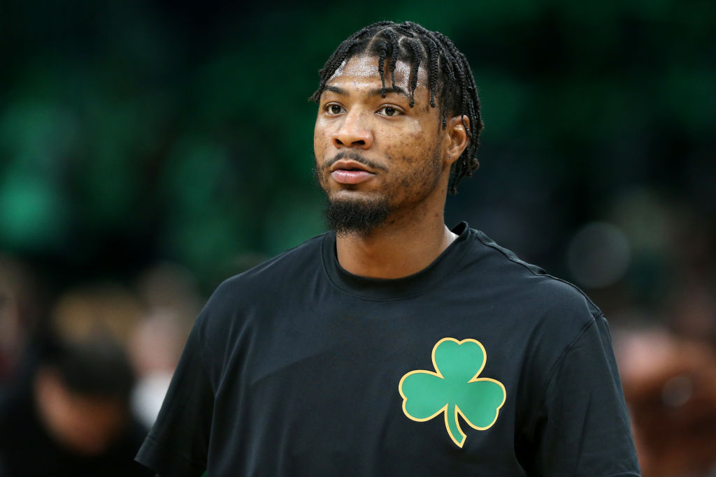 Celtics guard, Marcus Smart, warming up before a game.