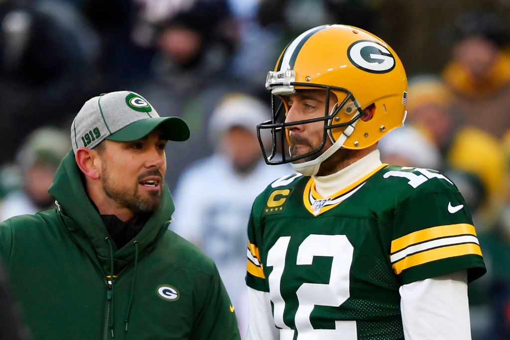 Head coach Matt LaFleur of the Green Bay Packers talks with Aaron Rodgers