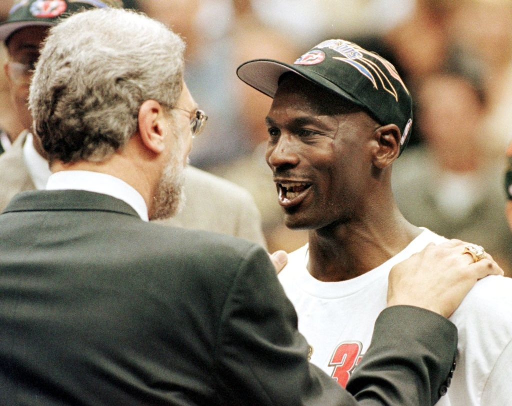Michael Jordan (R) and Chicago Bulls head coach Phil Jackson (L) congratulate each other 14 June after winning the NBA Finals