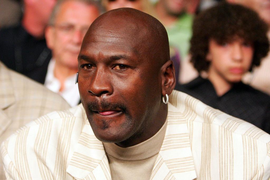 Michael Jordan sitting ringside for a boxing match.