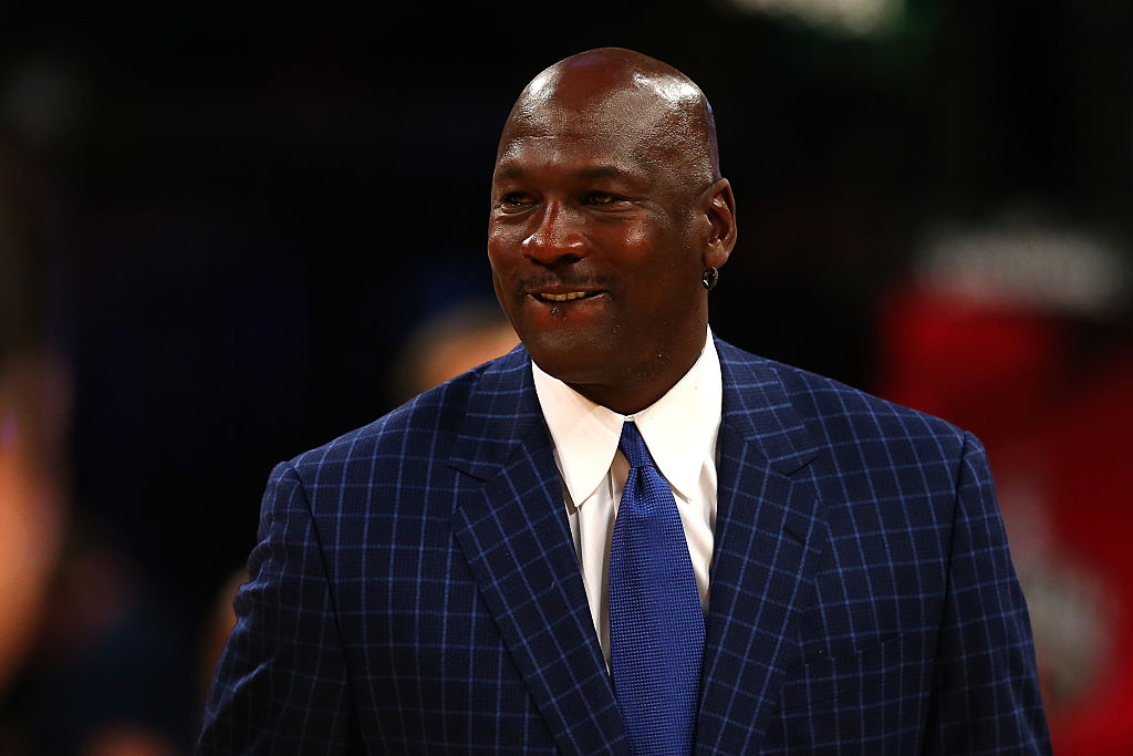 Michael Jordan watching the all-star game in Charlotte.