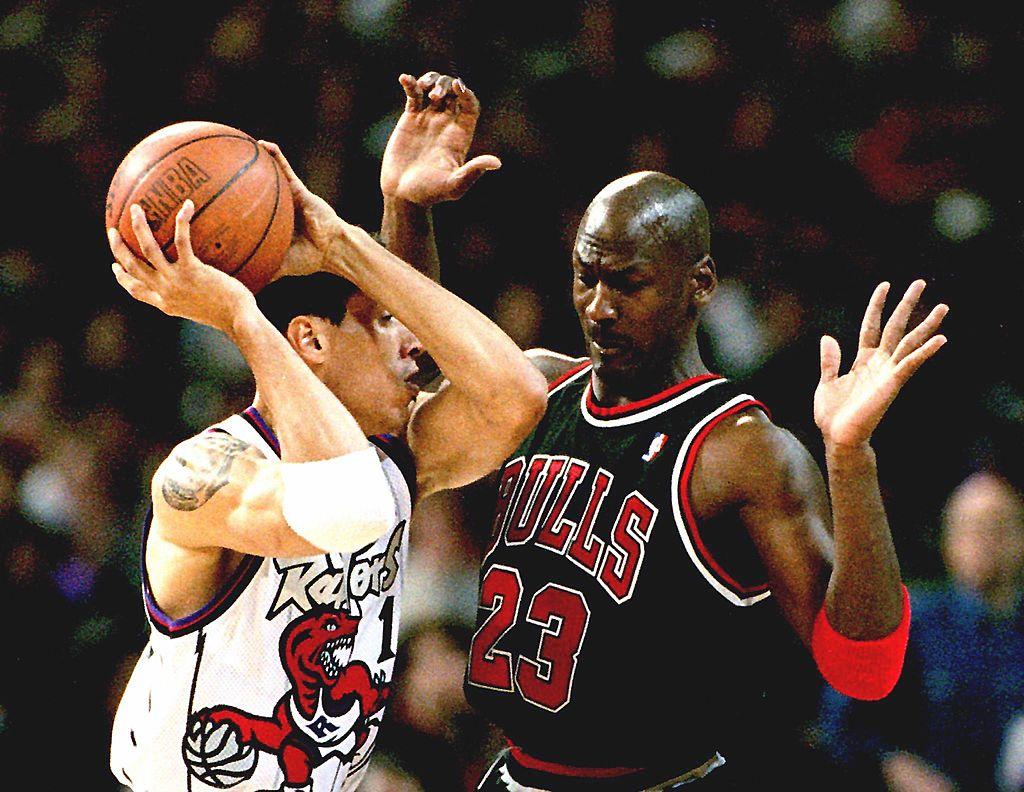 Doug Christie of the Toronto Raptors tries to pass the ball away from Michael Jordan of Chicago Bulls
