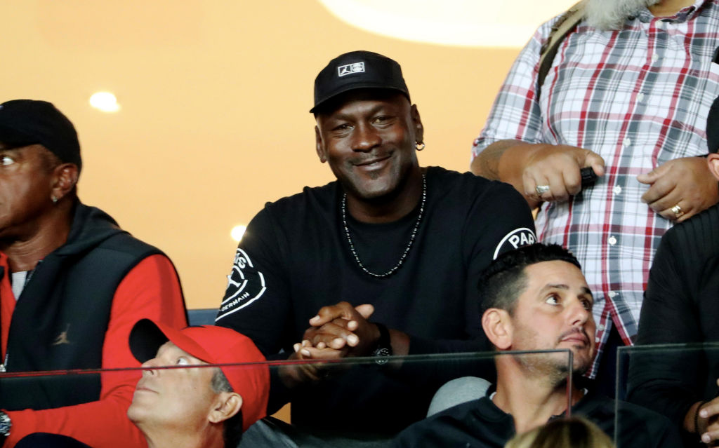 Michael Jordan attends a sporting event