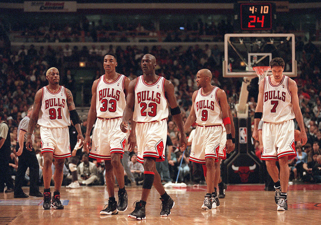Michael Jordan walking up the court with his teammates