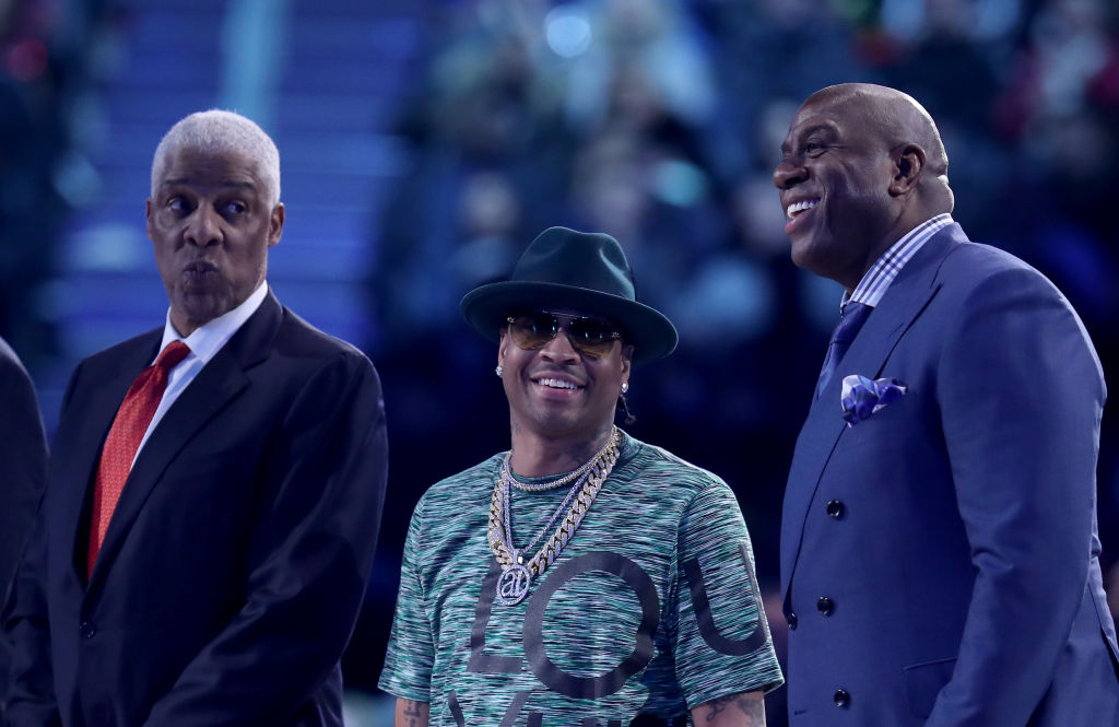 Magic Johnson (R), Allen Iverson (C) and Julius Irving react after being introduced at halftime