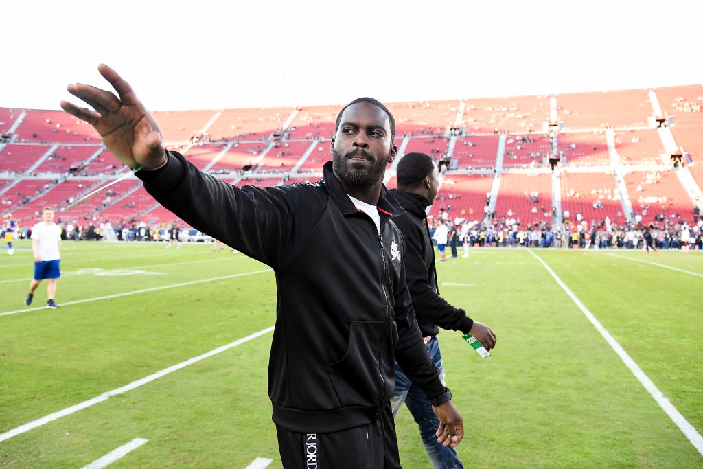 Former NFL Quarterback Michael Vick greets fans prior to a game