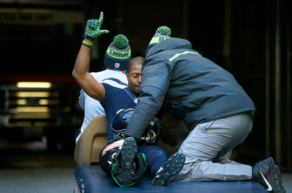 A football player is carted off the field after suffering a knee injury