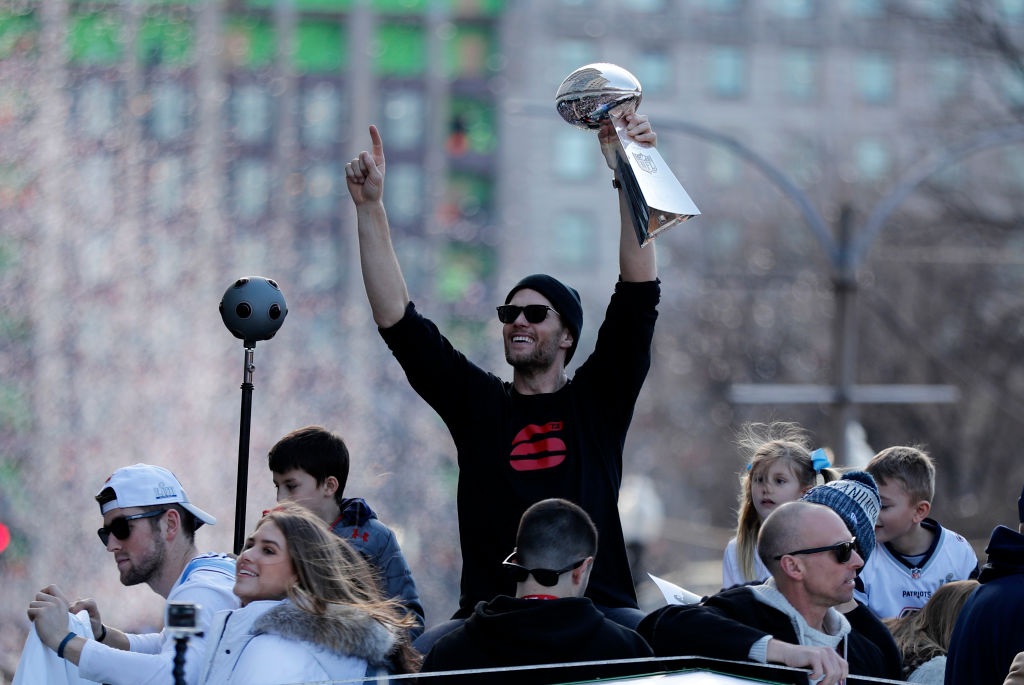 New England Patriots quarterback Tom Brady with one of the six trophies he has earned during the New England Patriots Super Bowl Victory Parade