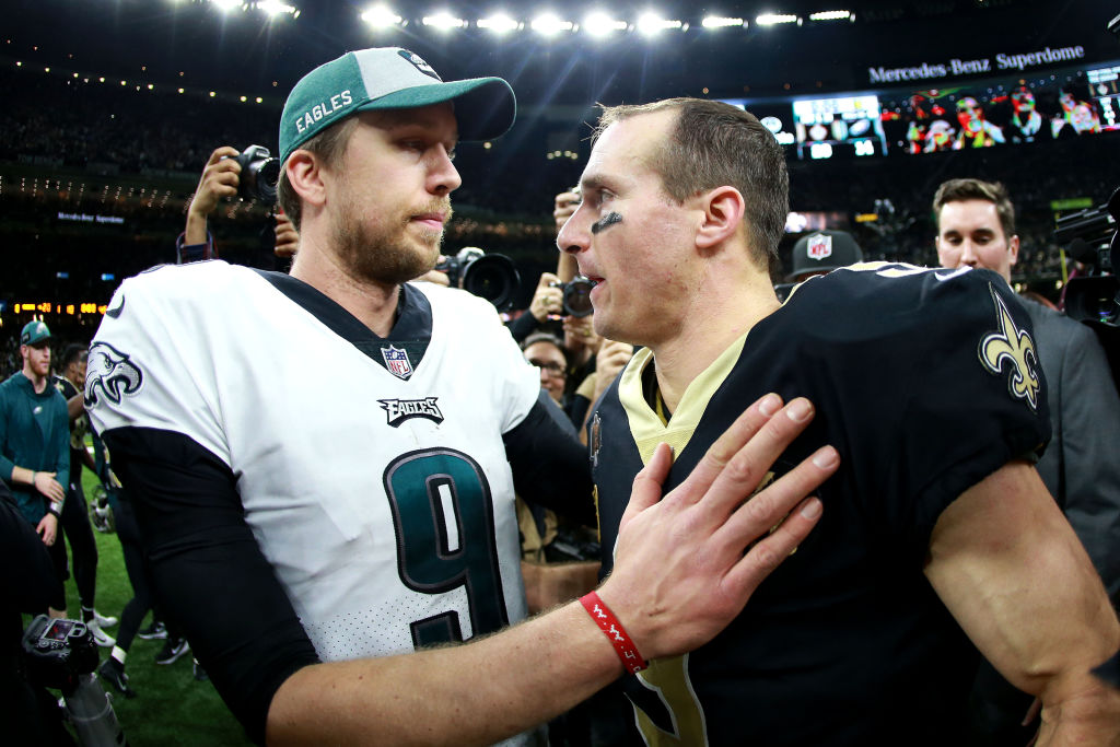 Nick Foles of the Philadelphia Eagles congratulates Drew Brees of the New Orleans Saints