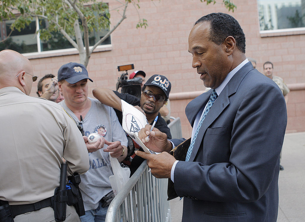 O.J. Simpson signs autographs as he leaves the Clark County Regional Justice Center in 2008