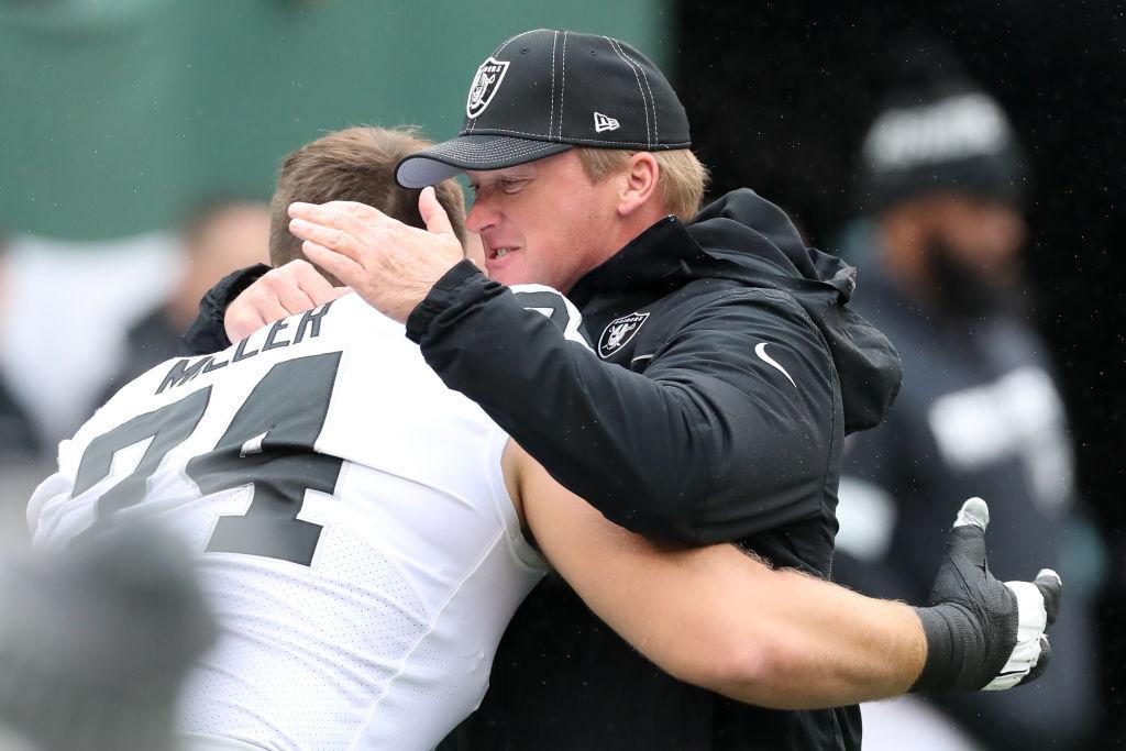 Oakland Raiders head coach Jon Gruden hugs offensive tackle Kolton Miller