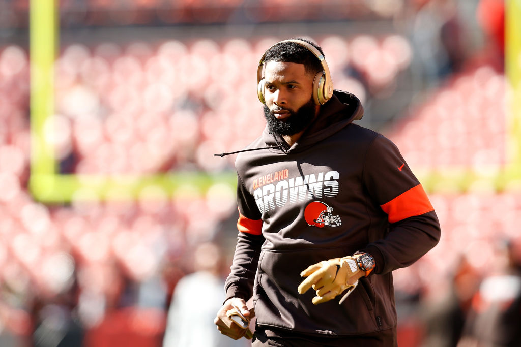 Odell Beckham, one of the only NFL players with a shoe deal, warms up before a game.