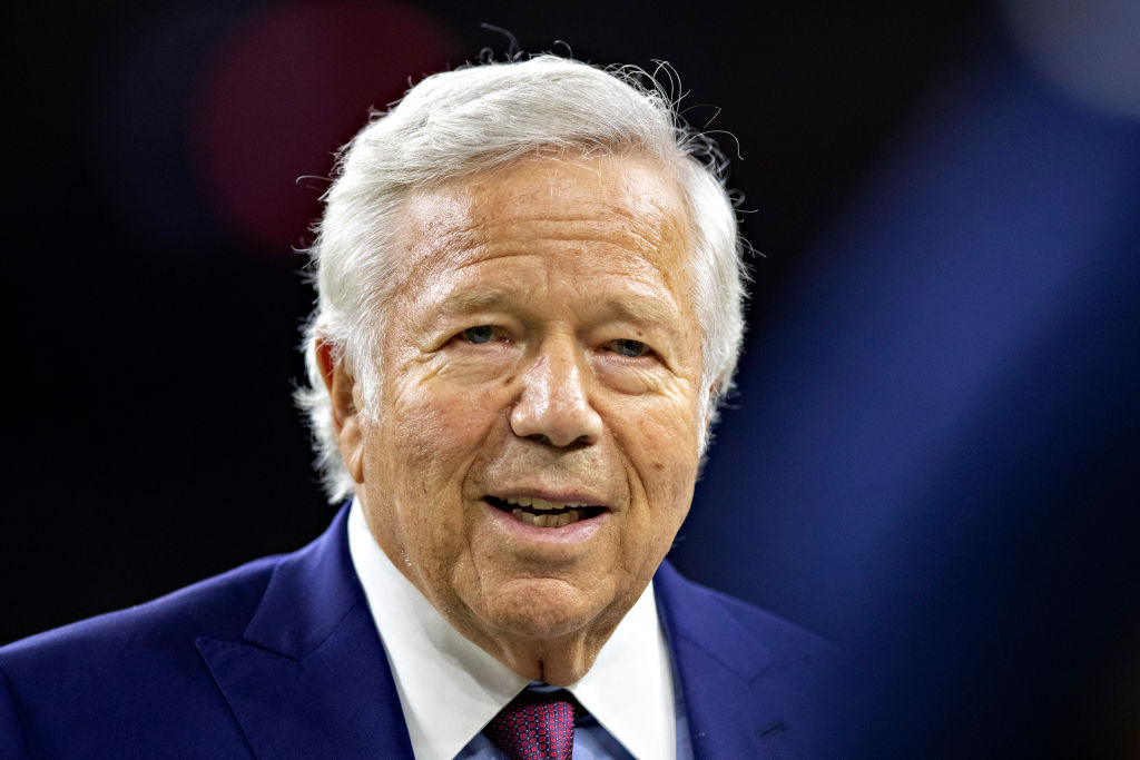 Owner Robert Kraft of the New England Patriots greets fans on the field