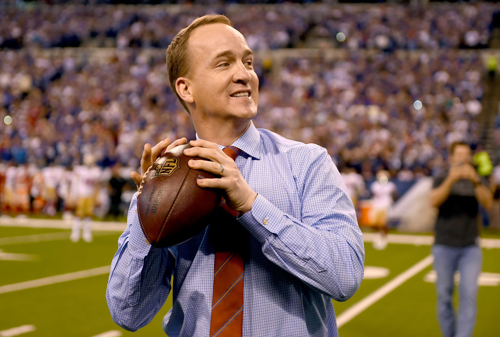 Peyton Manning throwing around a football before a game
