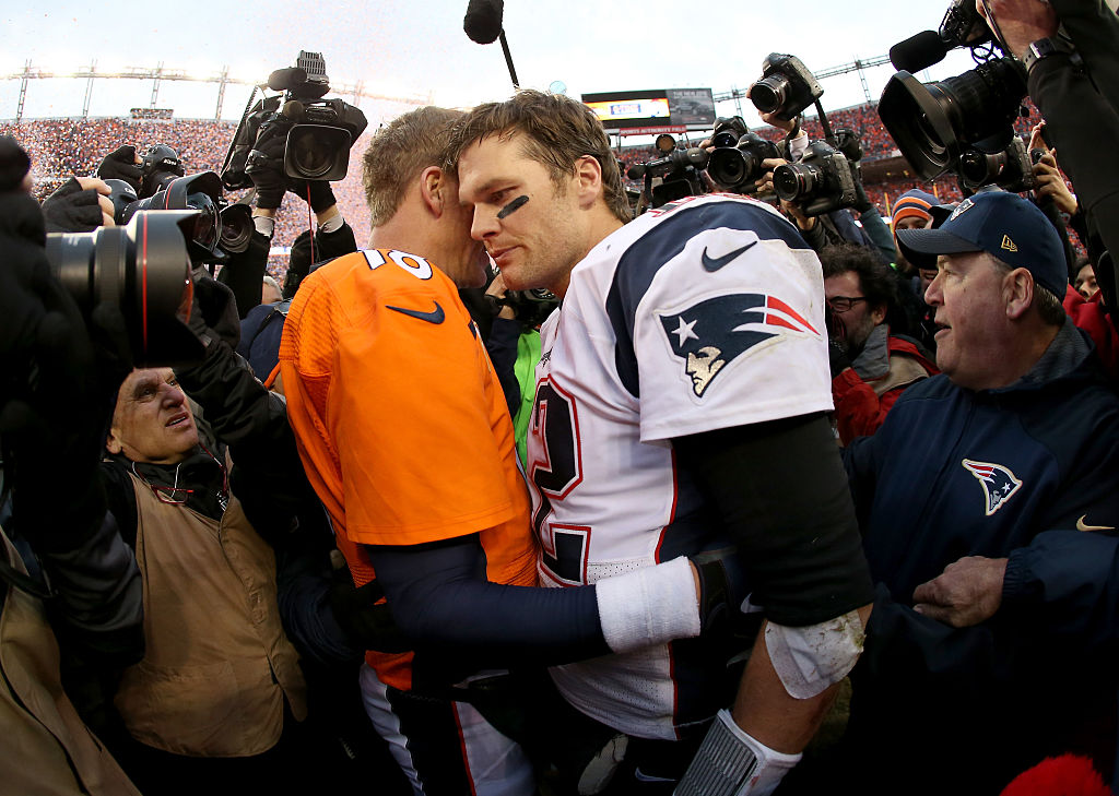 Peyton Manning of the Denver Broncos and Tom Brady of the New England Patriots speak after a game