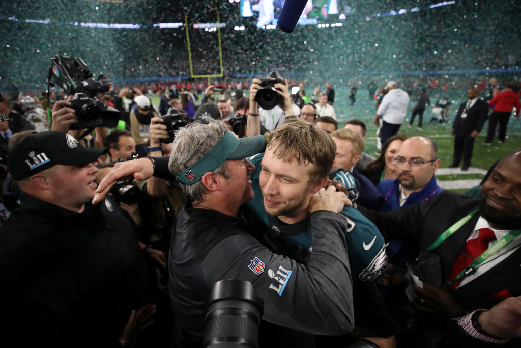 Philadelphia Eagles coach Doug Pederson embraces Eagles quarterback Nick Foles after winning Super Bowl LII