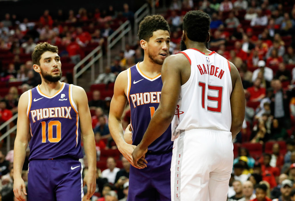 James Harden of the Houston Rockets and Devin Booker of the Phoenix Suns exchange words
