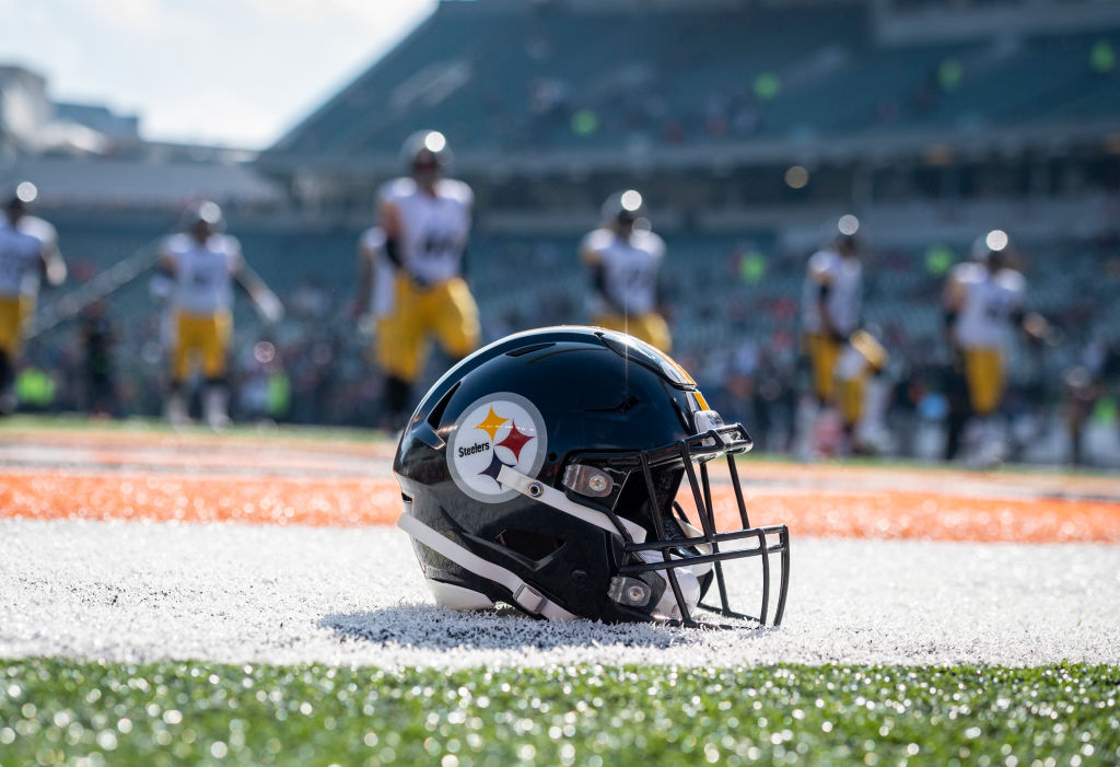A helmet sits in the end zone as the Pittsburgh Steelers warm up