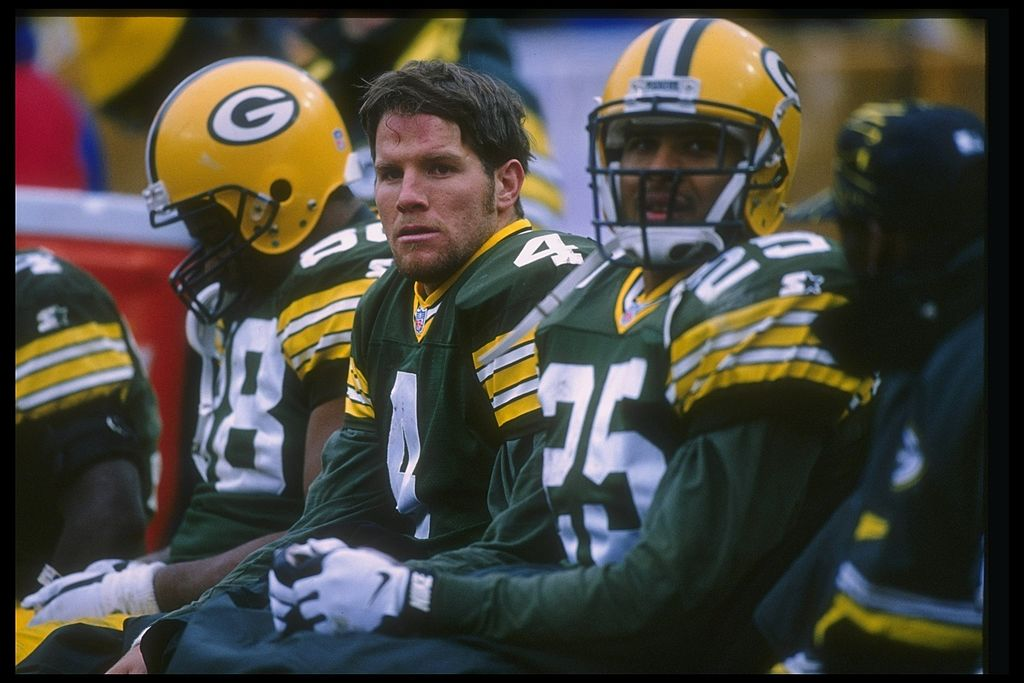 Quarterback Brett Favre of the Green Bay Packers looks on with teammates during a 1996 game