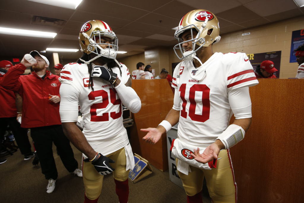 Richard Sherman and Jimmy Garoppolo of the San Francisco 49ers talk in the locker room prior to a game