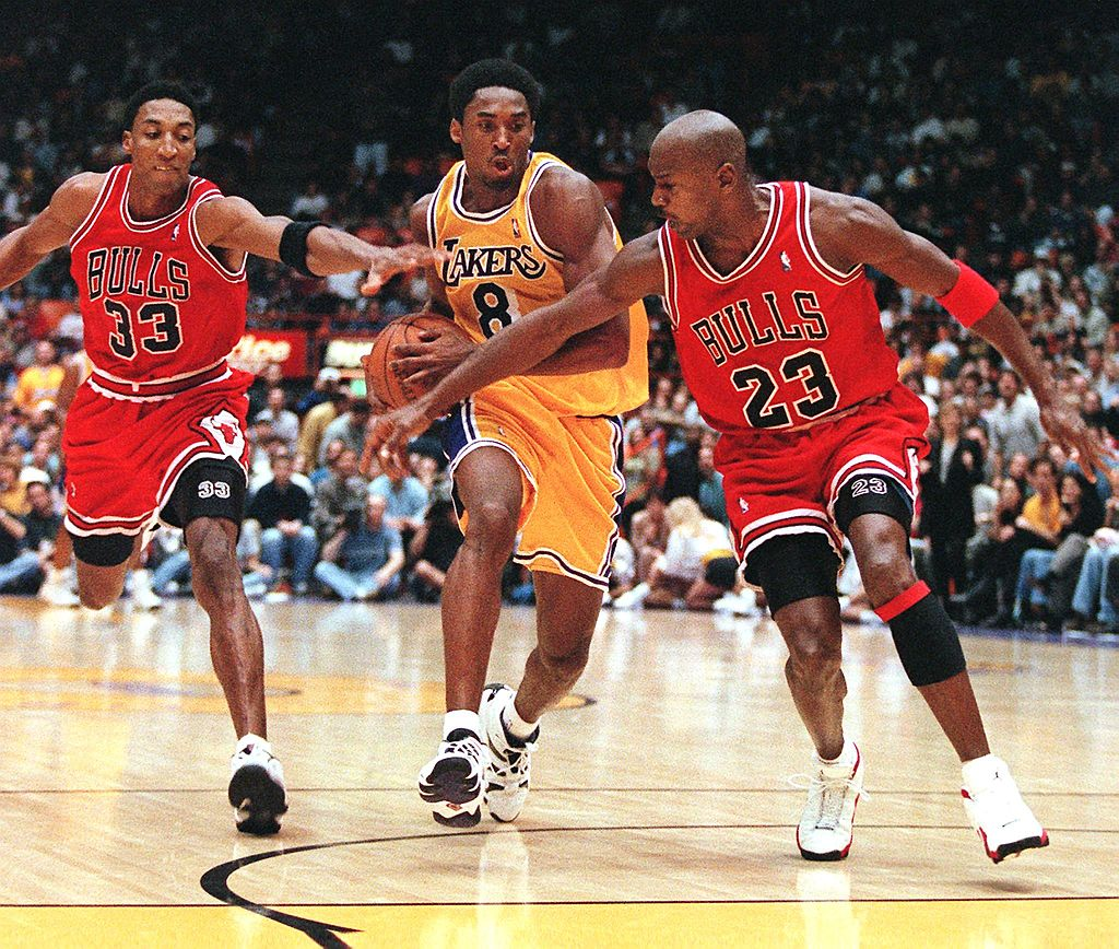 Scottie Pippen and Michael Jordan of the Chicago Bulls try to stop Kobe Bryant of the Los Angeles Lakers