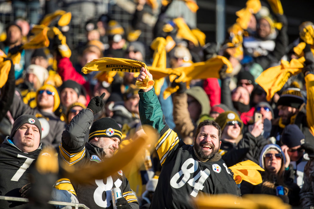 Pittsburgh Steelers fans wave terrible towels during the 2018 AFC Divisional Playoff game