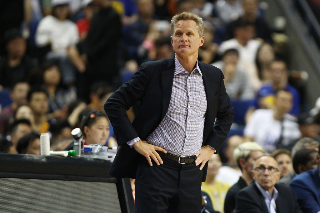 Steve Kerr coaching from the sideline during an NBA game.