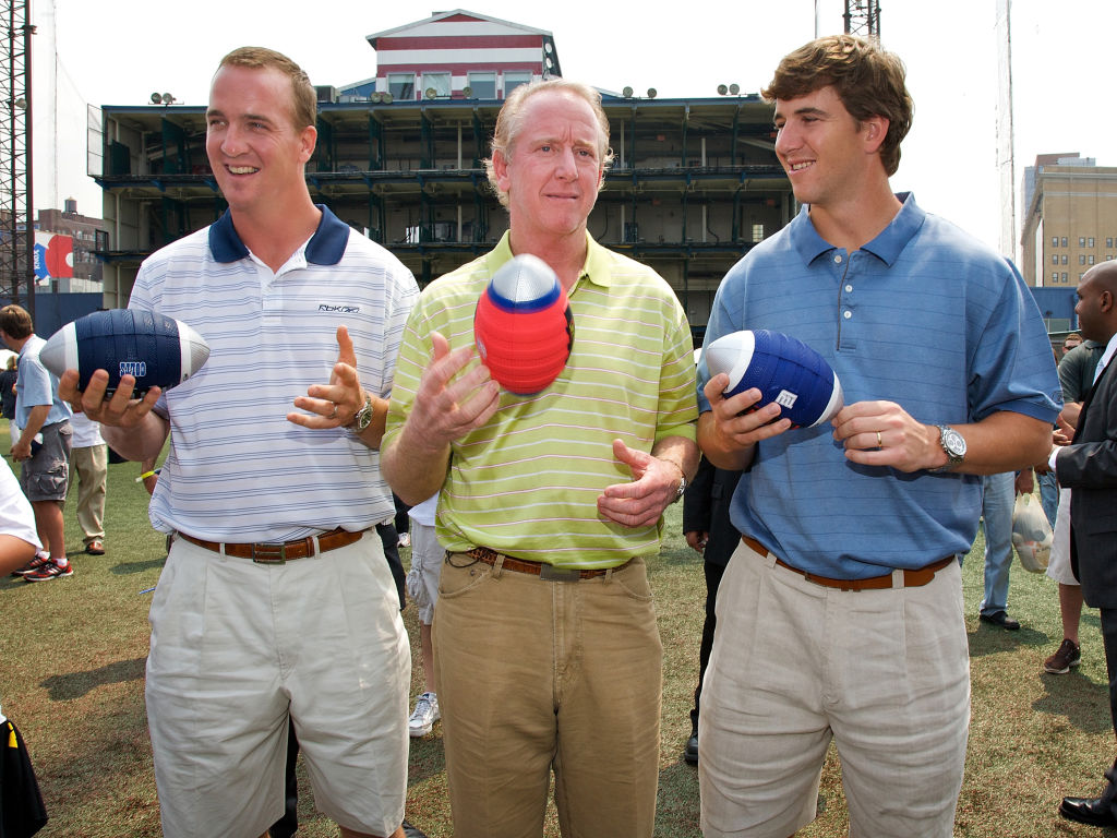 Peyton and Eli Manning pose with their father, Archie.