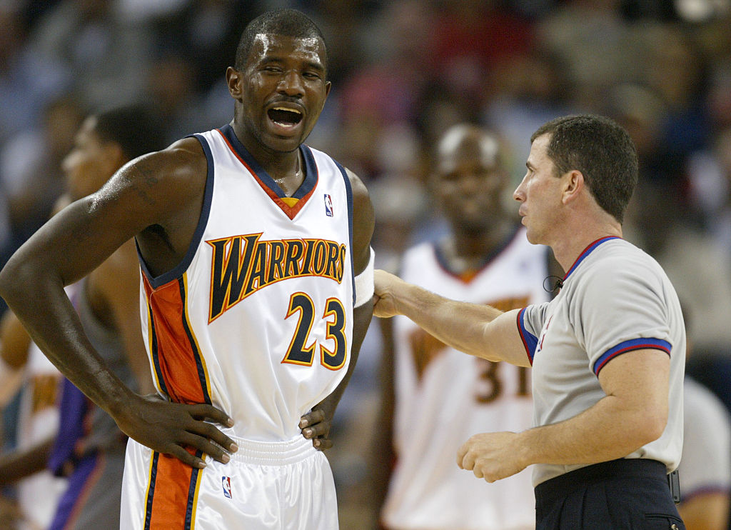 Tim Donaghy talks to a player on the Warriors