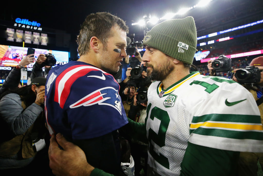 Tom Brady of the New England Patriots talks with Aaron Rodgers of the Green Bay Packers