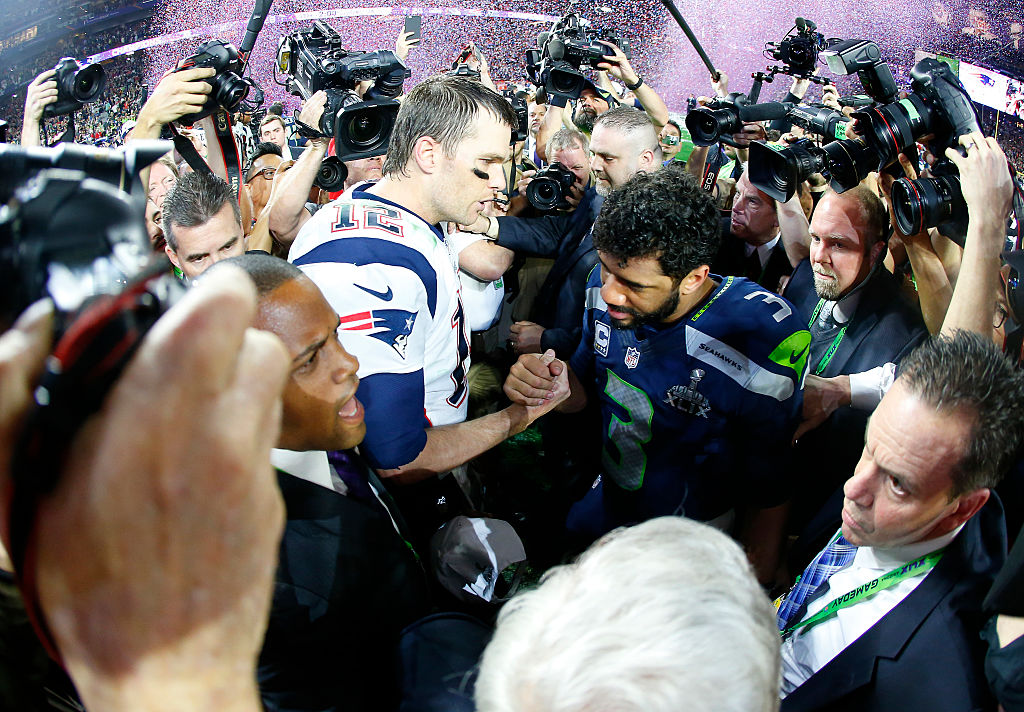 Tom Brady of the New England Patriots is congratulated by Russell Wilson of the Seattle Seahawks