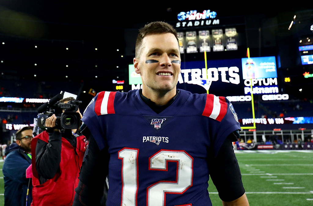 Tom Brady of the New England Patriots celebrates after defeating the New York Giants