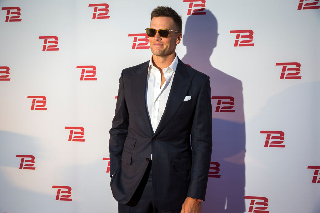 Tom Brady poses at a red carpet event for his new diet and lifestyle brand