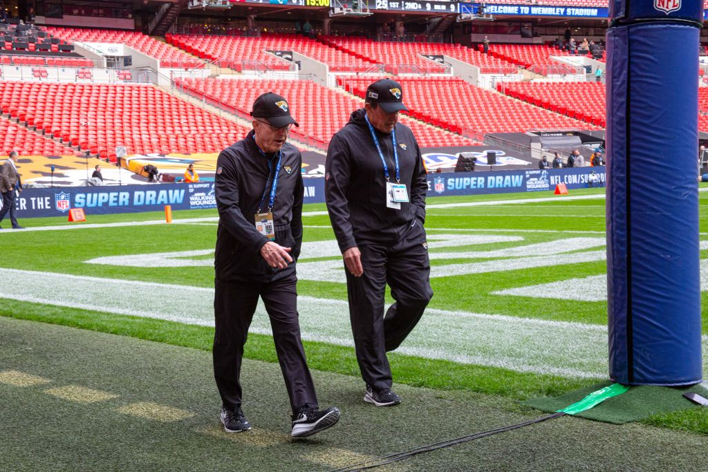 Tom Coughlin and Dom Capers of the Jacksonville Jaguars walk the field