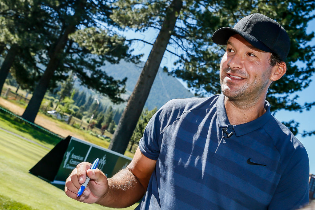Retired NFL player Tony Romo playing golf.