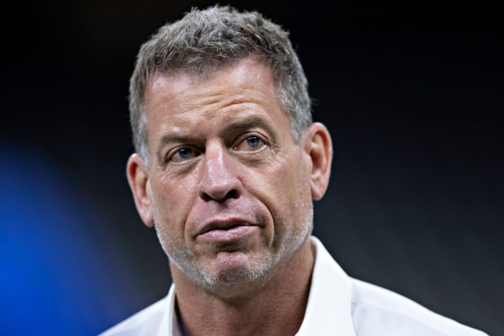 Former Cowboys quarterback Troy Aikman says owner Jerry Jones is making life tougher on head coach Jason Garrett.