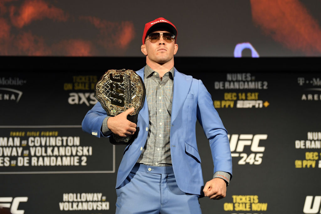 Colby Covington poses on stage during the UFC 245 press conference