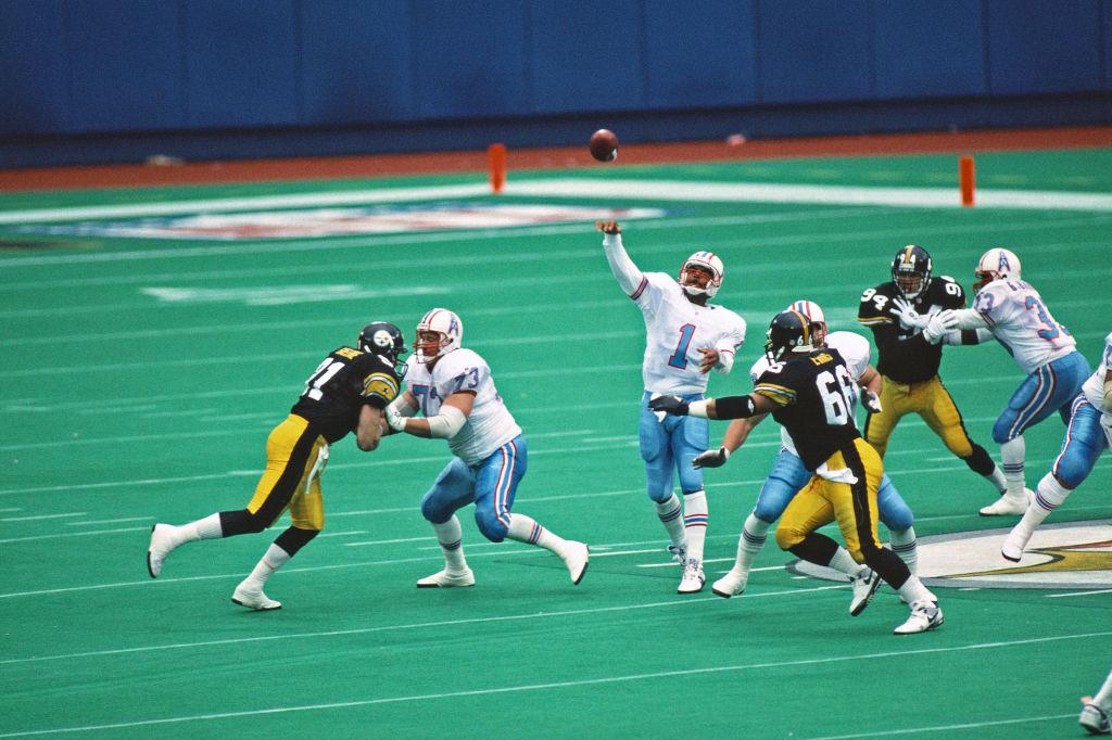 Hall of Fame NFL quarterback Warren Moon throws a pass.