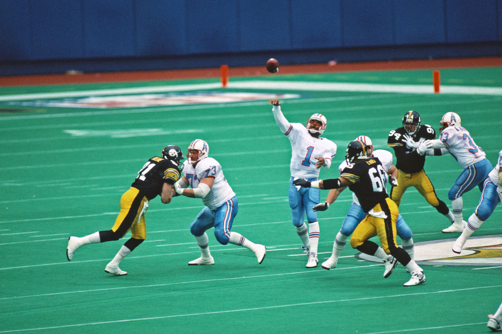 Hall of Fame NFL quarterback Warren Moon throws a pass.