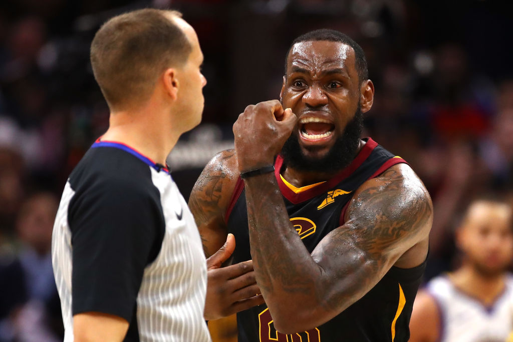An NBA referee getting yelled at by LeBron James