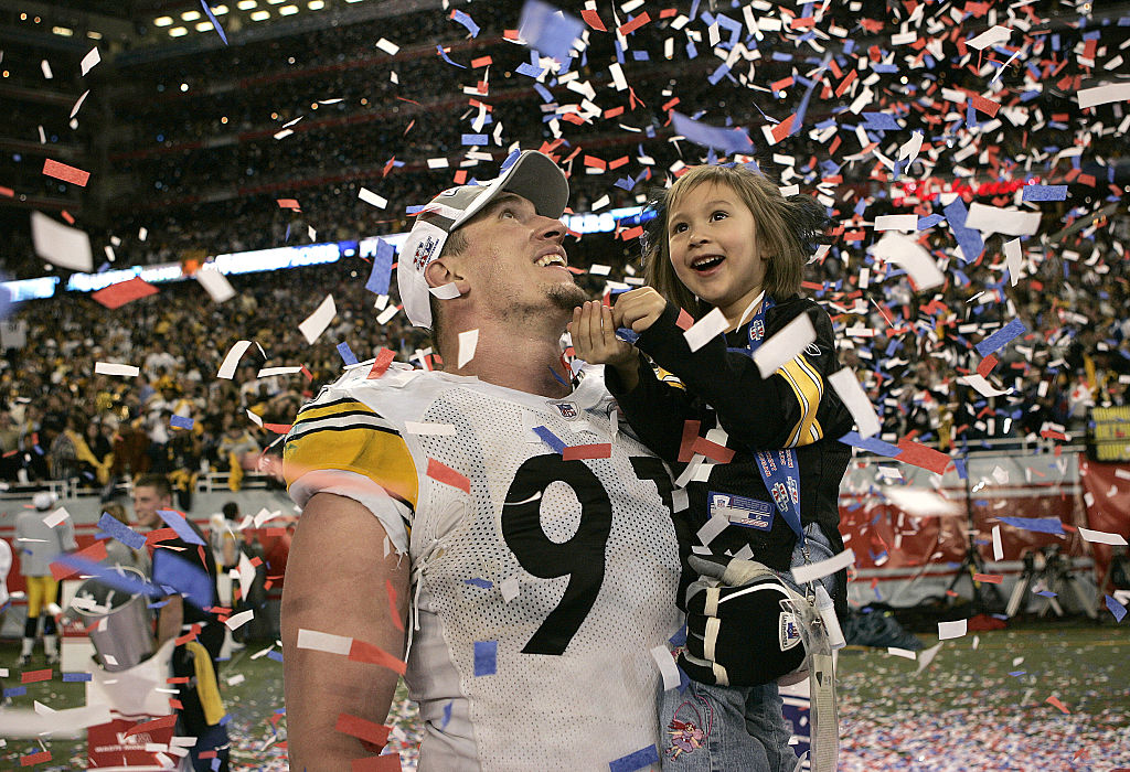 Aaron Smith of the Pittsburgh Steelers celebrates after winning Super Bowl XL in 2006