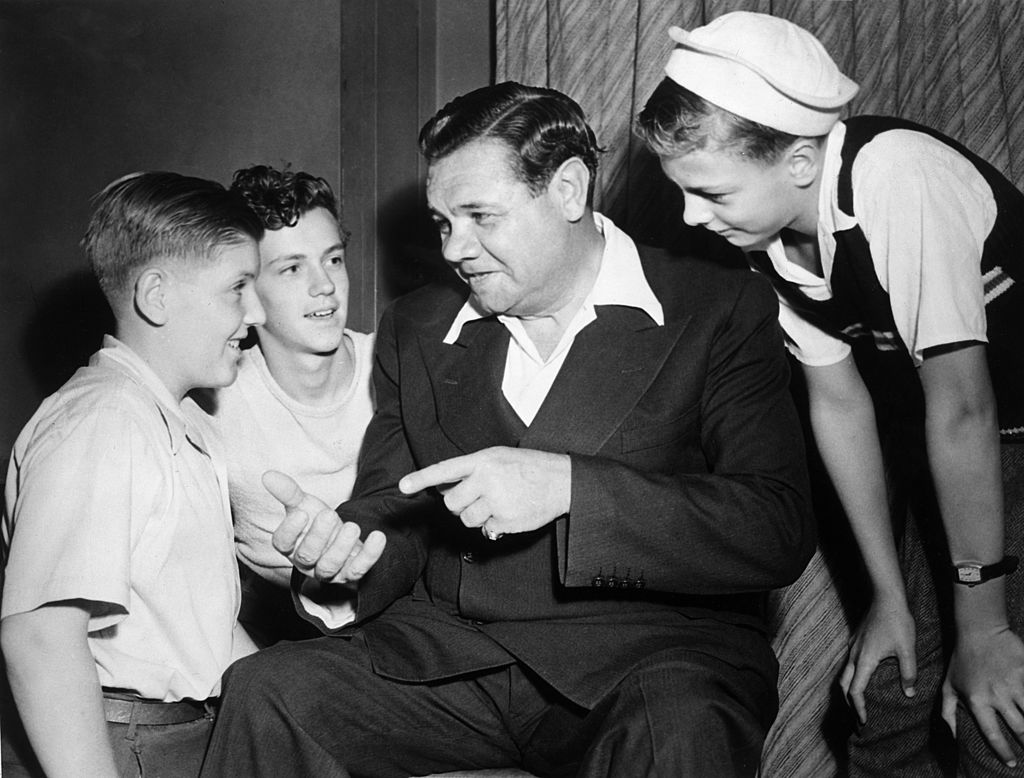 Baseball player Babe Ruth talks with young fans in 1944
