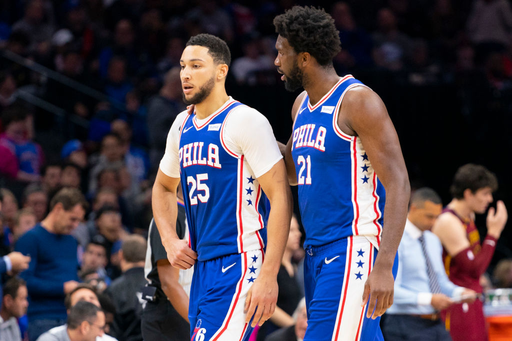 Ben Simmons and Joel Embiid of the Philadelphia 76ers walk to the bench