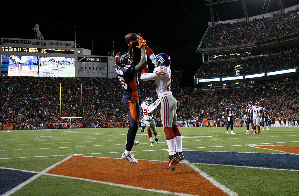 Corey Webster of the New York Giants breaks up a pass in the end zone intended for wide receiver Brandon Marshall of the Denver Broncos