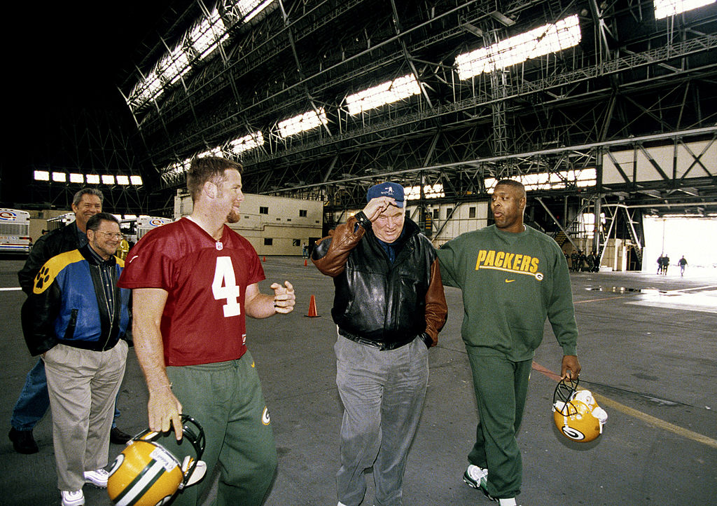 Green Bay Packers quarterback Brett Favre, Hall of Fame coach John Madden, and defensive end Reggie White before a game