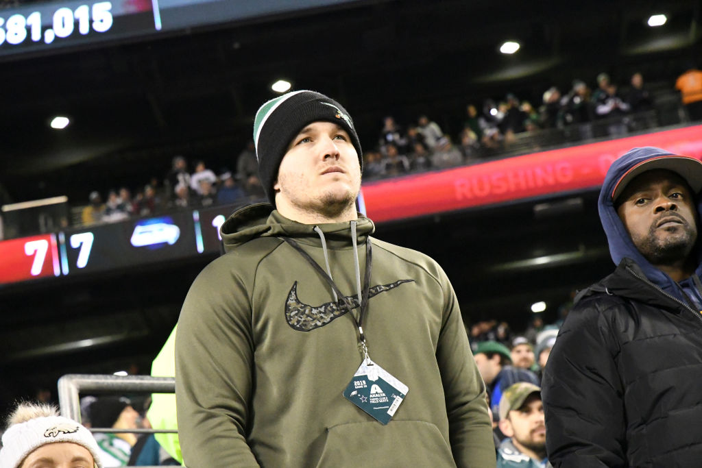California Angels Mike Trout takes in an NFL game