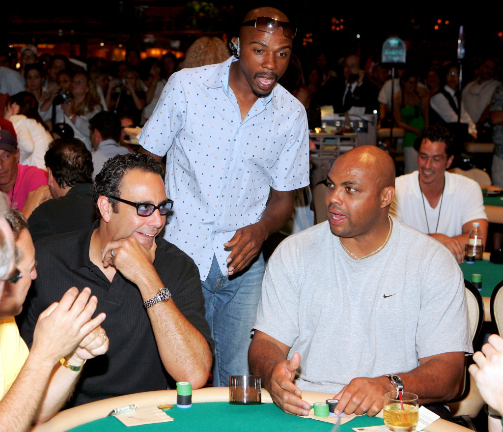 NBA analyst Greg Anthony (C) checks on Actor Brad Garrett (L) and TNT NBA analyst and former NBA player Charles Barkley (R) at the start of a charity poker tournament